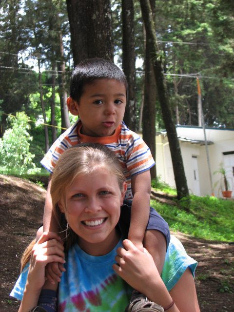 Allie and a child in Guatemala